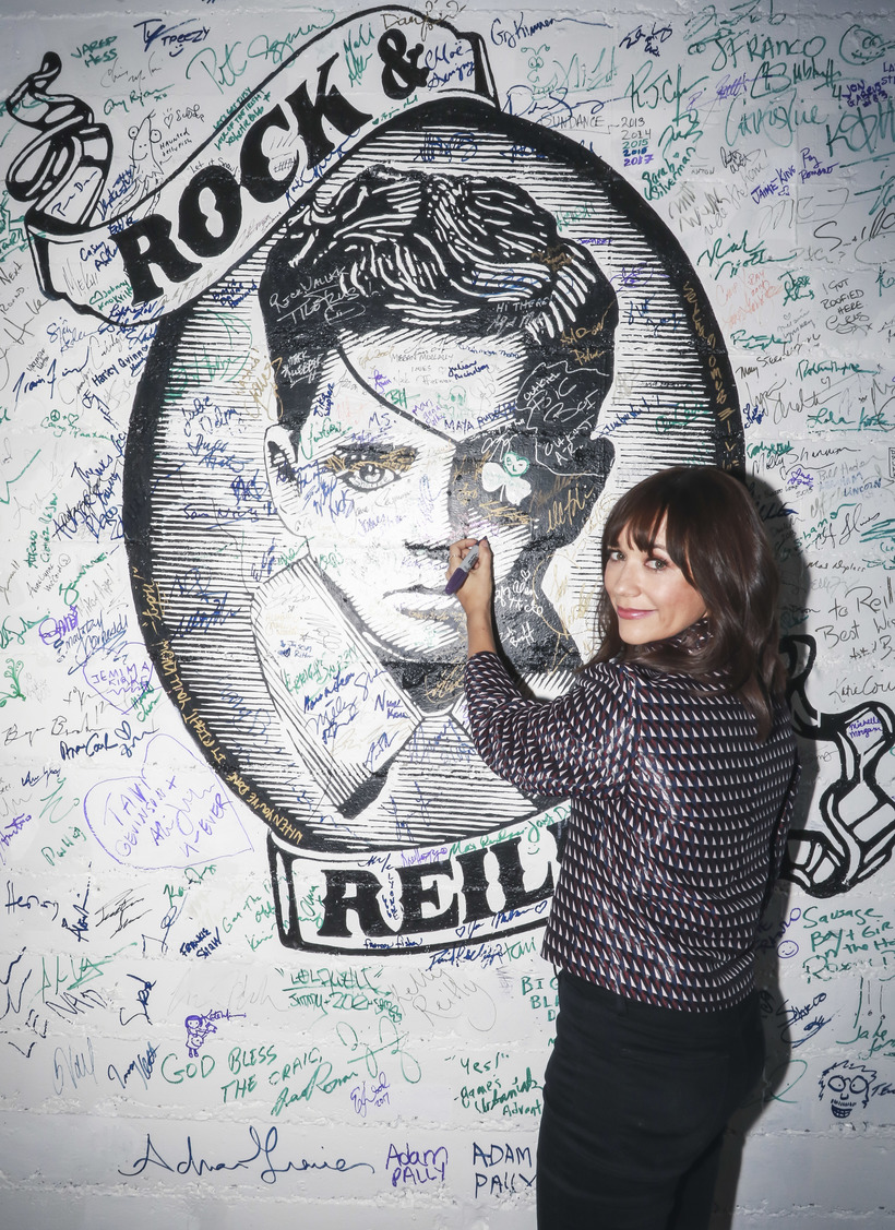 Michael Jacobson Rashida Jones signing the wall at Rock & Reilly's during the 2017 Sundance Film Festival.