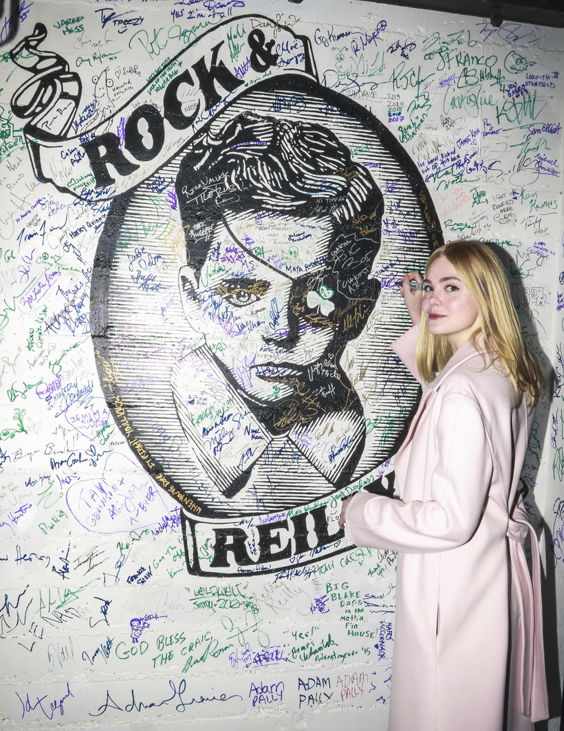 Michael Jacobson Elle Fanning signing the wall at Rock & Reilly's during the 2017 Sundance Film Festival.