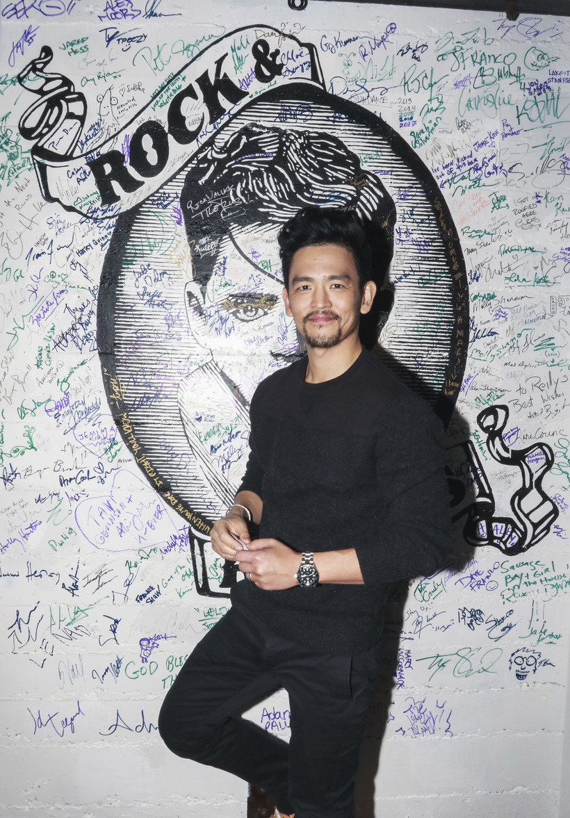 Michael Jacobson John Cho signing the wall at Rock & Reilly's during the 2017 Sundance Film Festival.