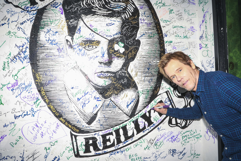Michael Jacobson Kevin Bacon signing the wall at Rock & Reilly's during the 2017 Sundance Film Festival.