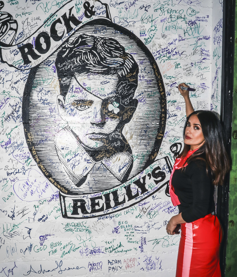 Michael Jacobson Salma Hayek signing the wall at Rock & Reilly's during the 2017 Sundance Film Festival.