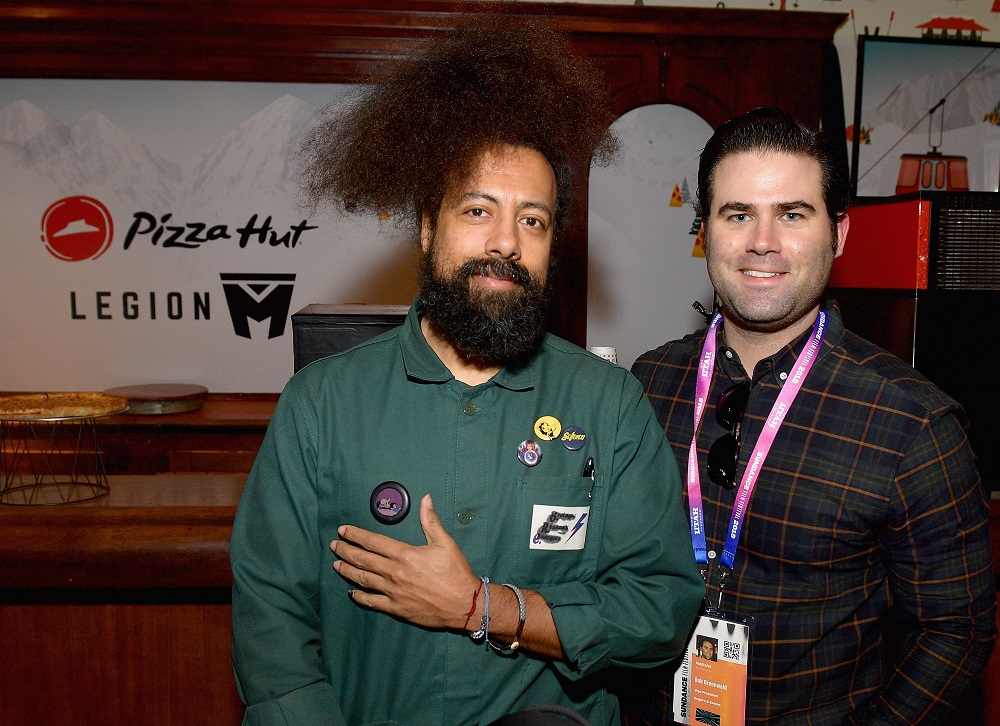 Comedian Reggie Watts (L) and Vice President of Rogers & Cowan, Rob Greenwald
