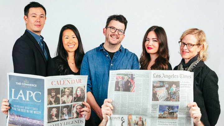Los Angeles Times Food staff (L-R): Lucas Kwan Peterson, Andrea Chang, Peter Meehan, Jenn Harris and Amy Scattergood in the back row; critics Patricia Escárcega and Bill Addison, behind the newspapers, in front. (Tiffany Roohani)